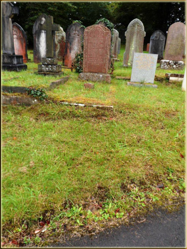 The grave of Tom Stephens is not marked with any stone. The grave is front of the red granite slab at Aberdare cemetery